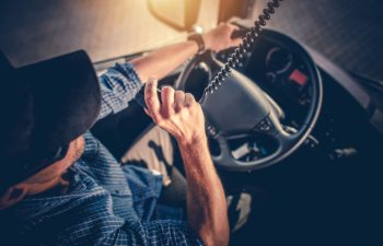semi-truck-driver-making-conversation-with-other-truck-drivers-through-cb-radio_1426-3998